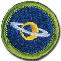 Astronomy merit badge, earned by Boy Scouts of America members after requirement completion. Blue patch featuring planet.