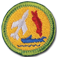 Astronomy merit badge, earned by Boy Scouts of America members after requirement completion. Orange patch featuring rocket.