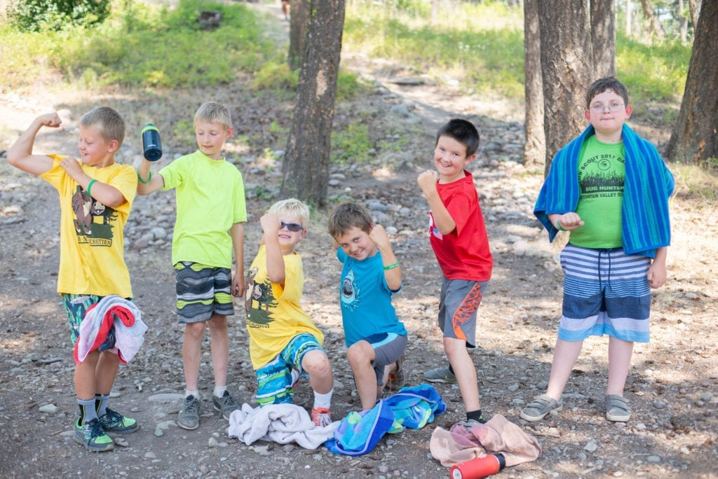 Six Boy Scouts smile and have fun at Webelos summer camp in Montana.