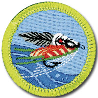 Fly fishing merit badge for Boy Scouts, featuring ornately tied casting fly
