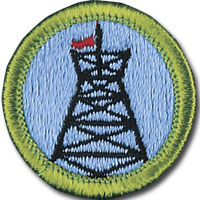 Pioneering merit badge for Boy Scouts, with headframe and flag