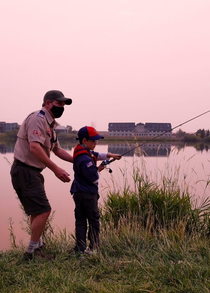 Photo Contest, Adult 2nd Place:   Rebecca Langlois, Den Leader, Pack 3671, Bozeman (Cubmaster Matt O'Brien teaching Wolf how to cast)