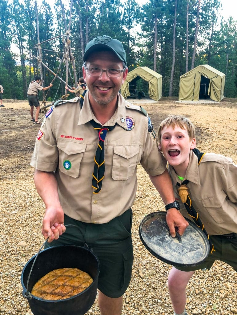 Photo Contest, First Place Winner:  Eric Henderson, Scoutmaster, Troop 1911, Missoula, (Leader with Dutch Oven Baklava for Scouts at K-M Scout Ranch)