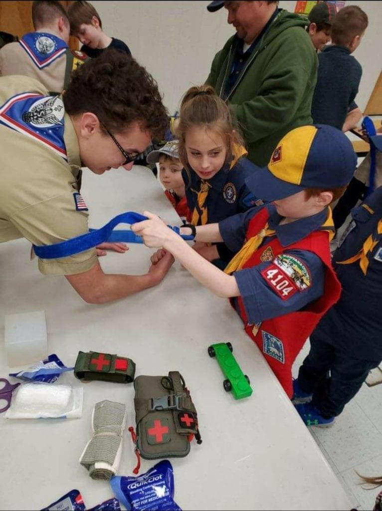 Photo contest, Adult Honorable Mention:  Tony Higuera, Committee Member, T. 1911, Missoula (Eagle Scout assisting Cub Scout with Stop the Bleed)