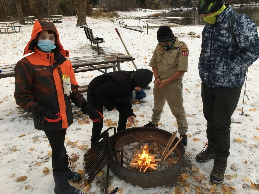 Photo contest, Youth 3rd Place Winner:  Gavin Carmichael, Troop 1936, Whitefish (New Scouts Making Fire (Covid Edition) Fall 2020)